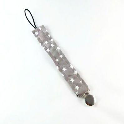 attache tétine étoiles blanches sur fond gris